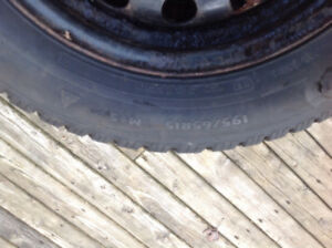 Set of 2 winter tires. 195/65/R15. Studded, with rims.