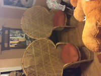 Two solid wicker chairs with cushions