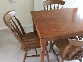 Pure wood brown dining table with four chairs