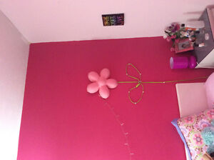 Wall clock, lamps, moon chair for a girl's room