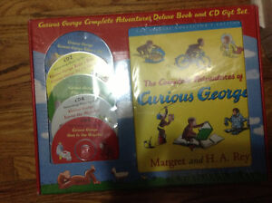 New - never opened Curious George collection with CDs for sale