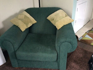 Large chair and ottoman with pillows