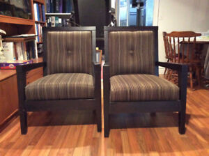 Pair of elegant black, brown and gold armchairs