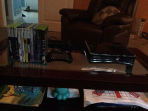 Xbox 360, Kinect, controller with keyboard pad and 12 games.
