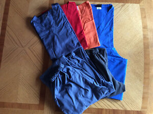 Assorted scrub pants and tops