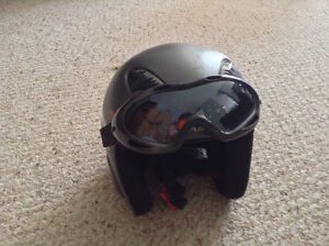 Small snowboarding helmet with goggles