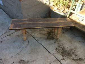 Rustic looking bench made from reclaimed wood