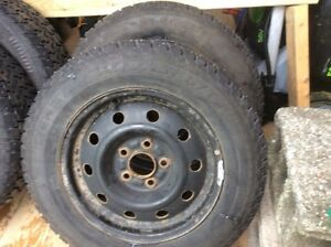 """Four 15"""" studded winter tires with rims St. John's Newfoundland image 2"""