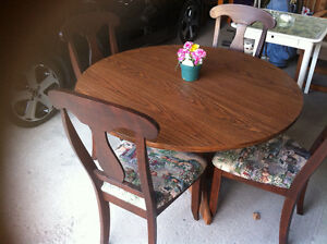 Solid oak table and 4 chairs and a massage table  some freebies