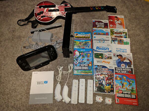 WII U BLACK 32gb deluxe, extra controllers, 14 games