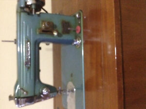 Antique Normac sewing machine in cabinet