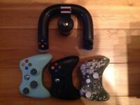 XBOx 360 (250 GB), 3 controllers, steering wheel controller, power pack, HDMI lead and 24 games.