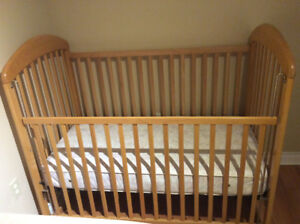 Solid maple crib with mattress.