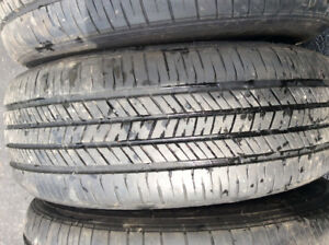 Set of four Goodyear summer tires on rims