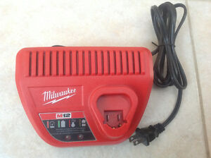 Milwaukee m12 12 volt battery charger power tools like new