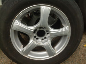 Four 16 x 7 inch, 5-114.3 ALLOY rims with tires