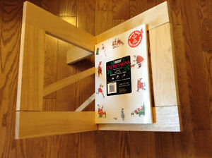 WOODEN MAGAZINE RACK IS HANDY AND FOLDS AWAY