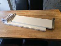 Two white IKEA shelves and brackets