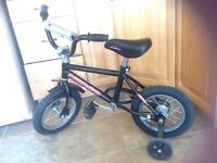 """Boy's Norco 12"""" wheel bike with removable training wheels"""