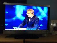 "TV/DVD COMBI 23"" AS NEW CONDITION TECHNIKA 1080HD"