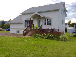Maison à revenue à vendre
