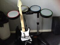 Xbox 360 guitar and drum set with pedal.