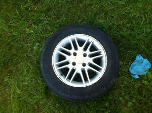 Aluminum rims with tires.