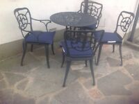 Cast aluminium garden table and 4 chairs black set 1