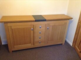 Large solid oak sideboard with marble inlay, excellent condition.