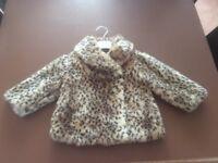 Small child's print coat
