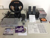 PlayStation 1 with V3 Racing Wheel and 13 games