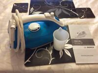 Bosh steam iron with instructions and water beaker