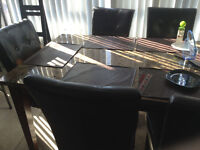 Marble dining room set with leather chairs