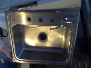 Koehler stainless sink with drinking water spigot and filter
