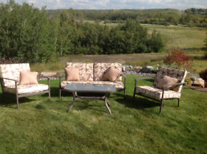 PATIO LOVESEAT WITH TWO MATICHING CHAIRS AND COFFEE TABLE