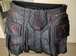 Black leather kilt with red pattern and pouches