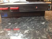 PlayStation 2 with two memory cards