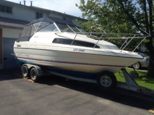 1993 Bayliner Classic 2252 with tandem axel trailer.