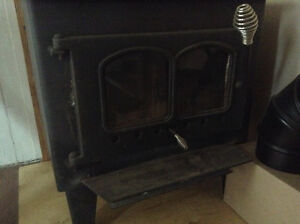 Wood stove with new pipes and fire woods, 500$