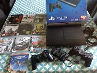 Boxed PS3, 2 wireless controllers, 10 games & charger for controllers
