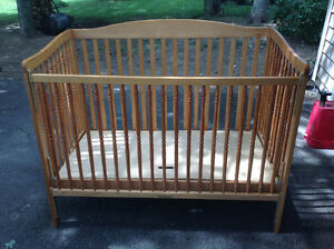 Oak coloured crib in good used condition