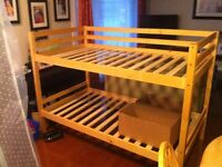 SOLID WOOD BUNK BEDS SPLIT INTO SINGLE BEDS $150.