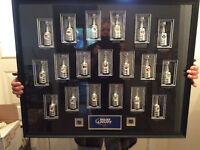 19 Stanley Cups in case and Hockey Hall of Fame Book