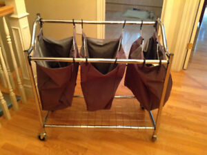 Clothing baskets 3 compartments on wheels like new $39