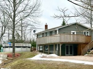 1.2 Acres, Pool, Garage, Lake Frontage and so much MORE!