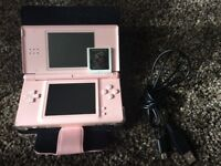 Pink Nintendo DS Lite with USB charger and game.