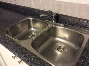 Double kitchen sink and kitchen faucet Moen