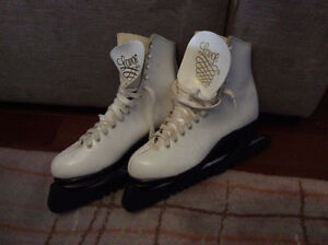 White leather figure skates with guards