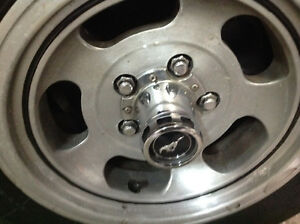 14 inch rims and caps and tires for 1973 mustang