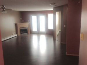 One Bedroom + Den with Heated Parking